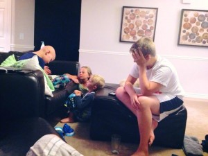 Ashtyn reading scriptures to the family.  Some normalcy.
